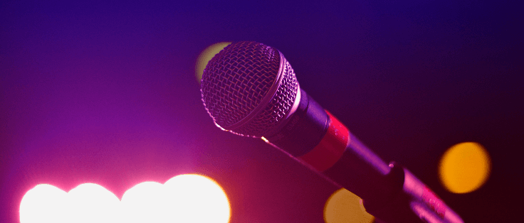 Lone microphone on stage with lights